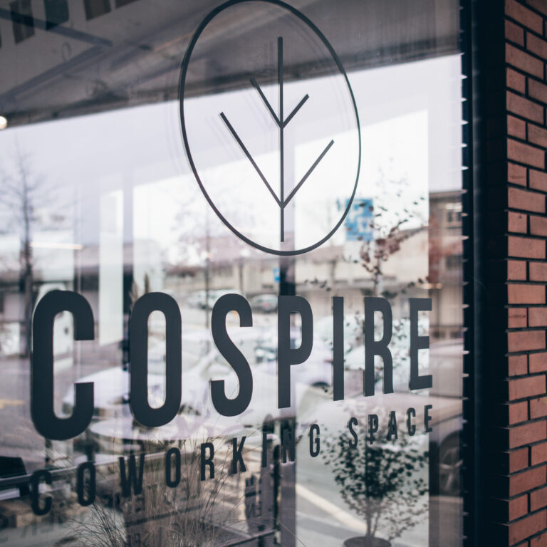 Cospire coworking and event space logo on our west window ou rue de Genève 100 in Lausanne